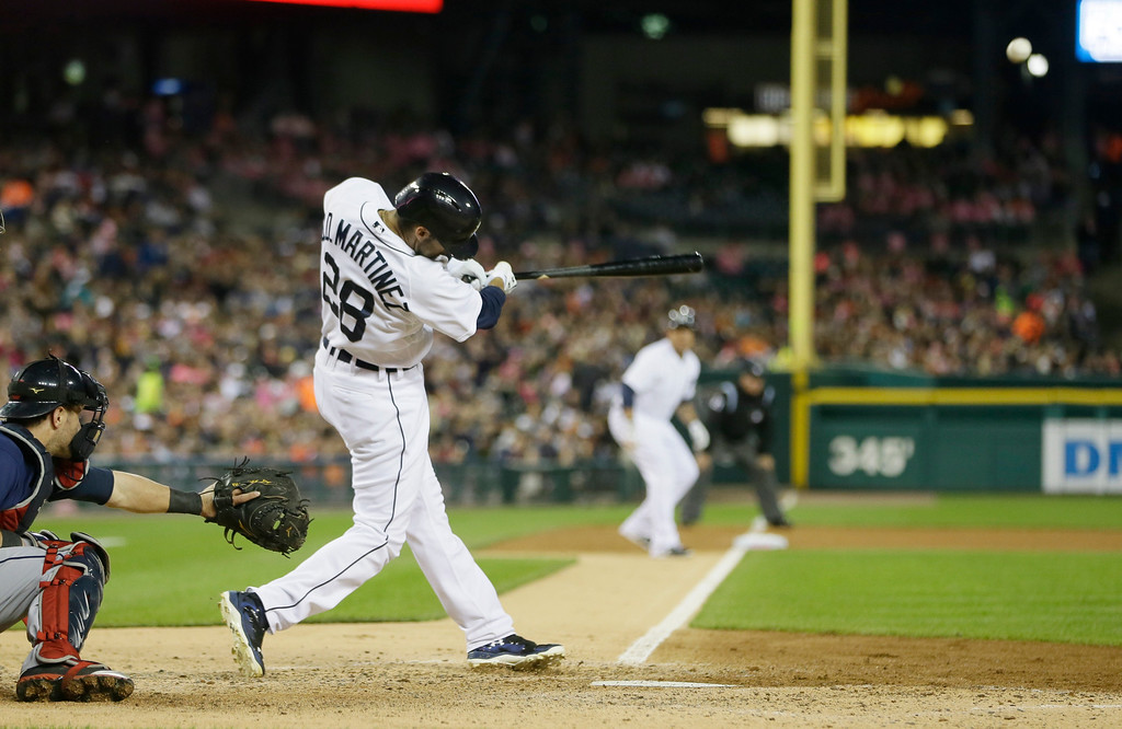 . Detroit Tigers\' J.D. Martinez connects for a two-run home run during the fourth inning of a baseball game against the Cleveland Indians in Detroit, Friday, Sept. 12, 2014. (AP Photo/Carlos Osorio)