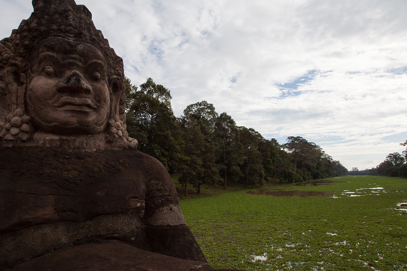 A close-up of a demon on the causeway outside the south gate to Angkor Thom.