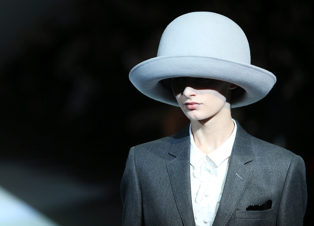 . A model wears a creation for Emporio Armani women\'s Fall-Winter 2014-15 collection, part of the Milan Fashion Week, unveiled in Milan, Italy, Friday, Feb. 21, 2014. (AP Photo/Antonio Calanni)