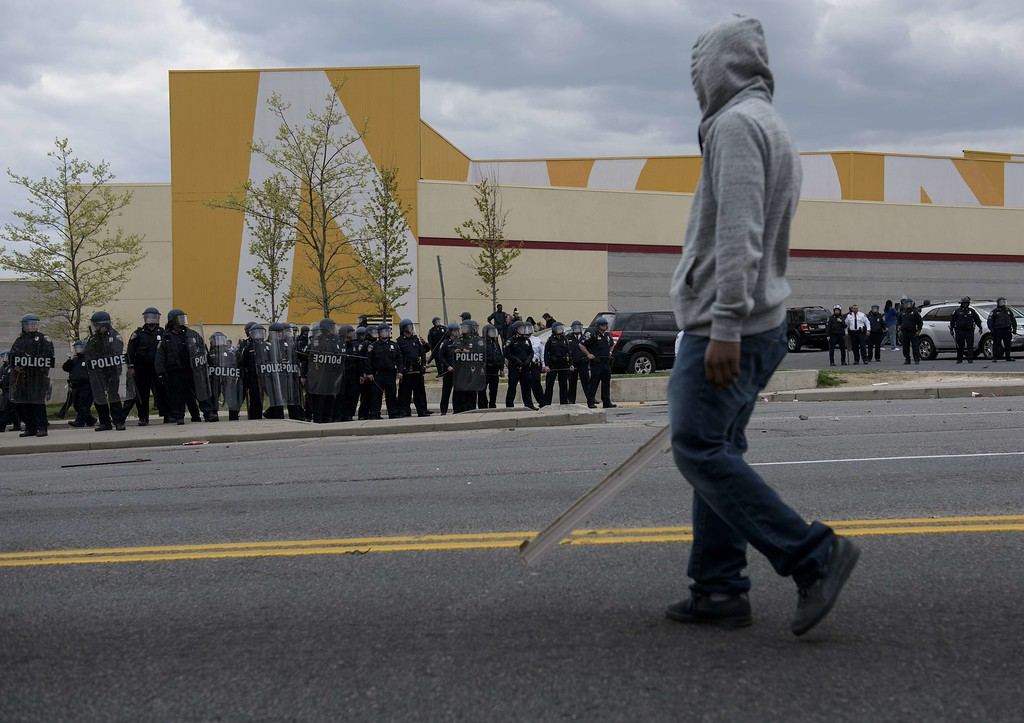 . Police form a line near Mondawmin Mall on April 27, 2015 in Baltimore, Maryland,  where violent street clashes erupted after friends and family gathered for the funeral of Freddie Gray, a 25-year-old black man whose death in custody triggered a fresh wave of protests over US police tactics.  Police said at least seven officers were injured -- one of them was unresponsive -- as youths hurled bricks and bottles and destroyed at least one police vehicle in the vicinity of the shopping mall not far from the church where the funeral took place.  AFP PHOTO / BRENDAN SMIALOWSKIBRENDAN SMIALOWSKI/AFP/Getty Images