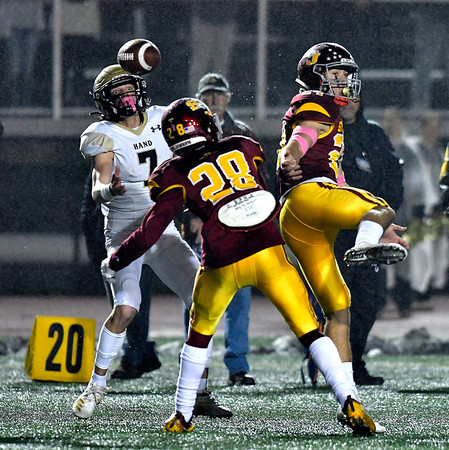 12/14/2019 Mike Orazzi | Staff Daniel Hand's Seth Sweitzer (7) catches a tipped pass during a 17-13 St. Joseph win at Veteran's Stadium in New Britain on Saturday. .