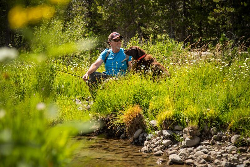 Fishing man and dog
