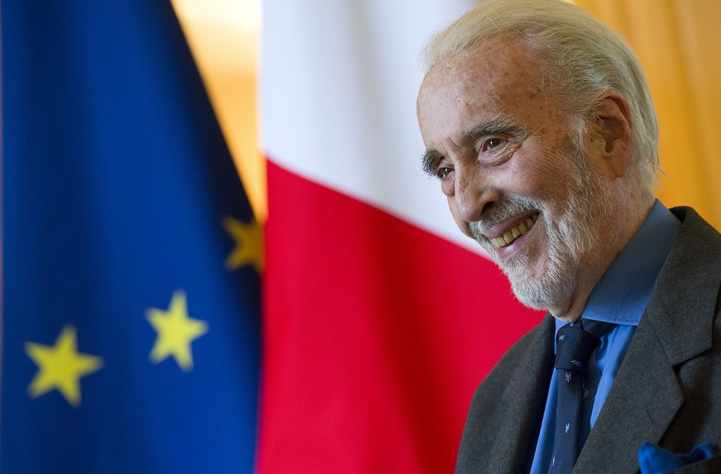 . British actor Christopher Lee smiles during a ceremony where he was presented with the Insignia of Commandeur de L\'Ordre des Arts et Lettres honoring his contribution to the fields of art and literature at the residence of the French ambassador to Britain Bernard Emie in London on December 16, 2011. Lee has performed roles in more than 275 films since 1947 and became famous for his role as Count Dracula in a string of Hammer Horror films. (ADRIAN DENNIS/AFP/Getty Images)
