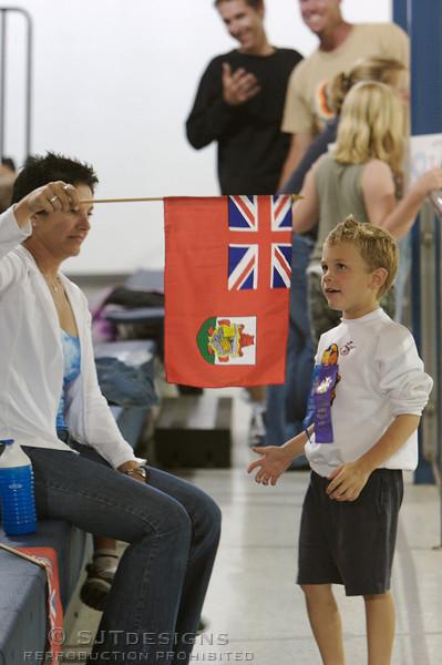 Bermudian nationals admire the flag.