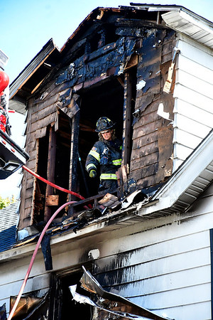 9/20/2019 Mike Orazzi | StaffrBristol firefighters after being called back to the scene of an early morning fire in a multifamily home on Jerome Avenue in Bristol. The fire was reportedly brought under control quickly and one occupant was treated for smoke inhalation. The cause is under investigation.