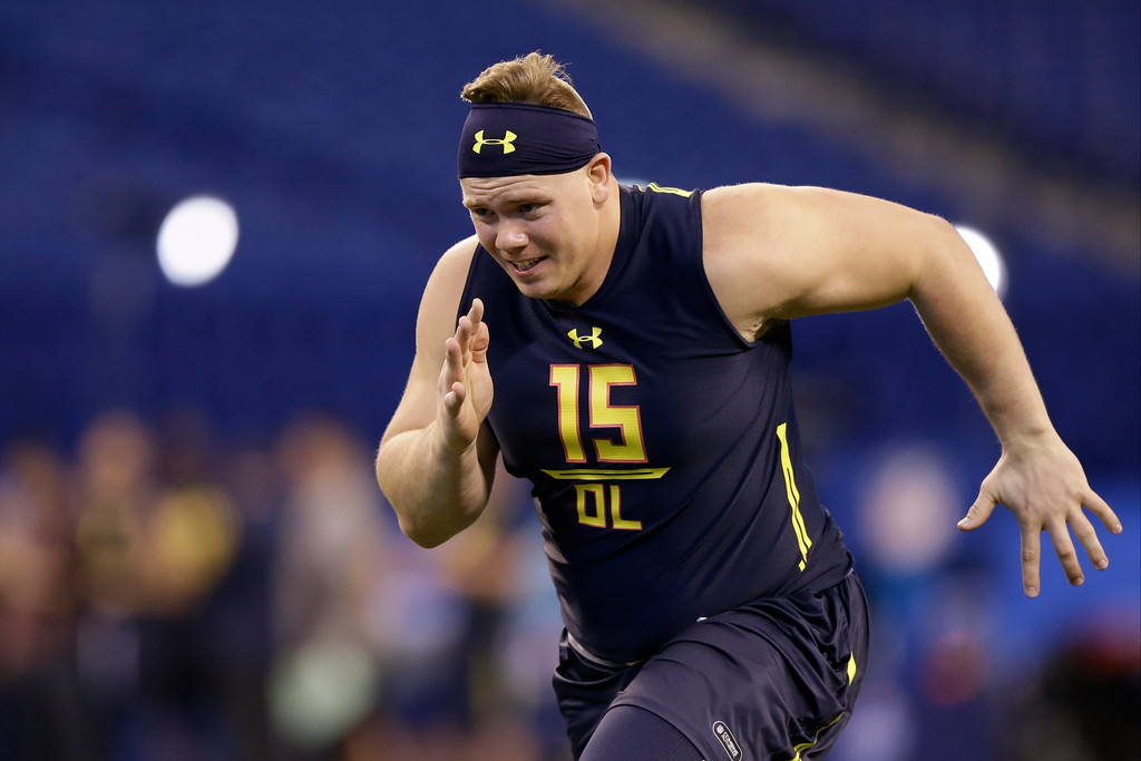 . Ohio State offensive lineman Pat Elflein runs a drill at the NFL football scouting combine in Indianapolis, Friday, March 3, 2017. (AP Photo/Michael Conroy)