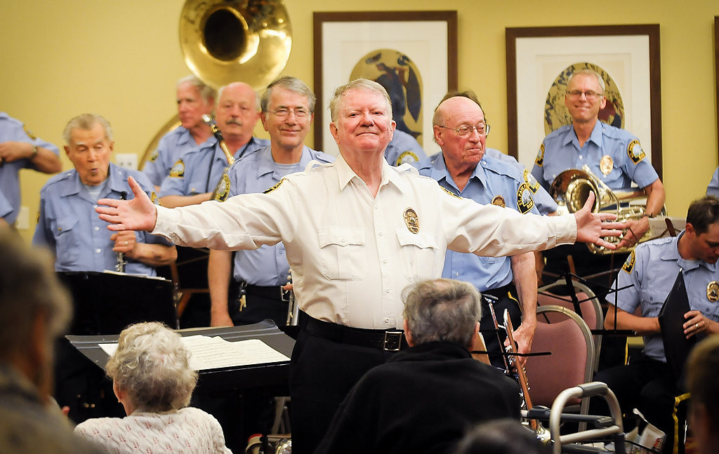 . Band director Bob Dynan turns to the audience after the St. Paul Police Band, which is celebrating its 90th anniversary this week, finished the concert Tuesday. (Pioneer Press: Ben Garvin)