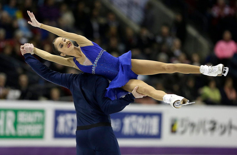 . Vera Bazarova and  Yuri Larionov, of Russia, perform during the pairs short program at the World Figure Skating Championships Wednesday, March 13, 2013, in London, Ontario. (AP Photo/Darron Cummings)