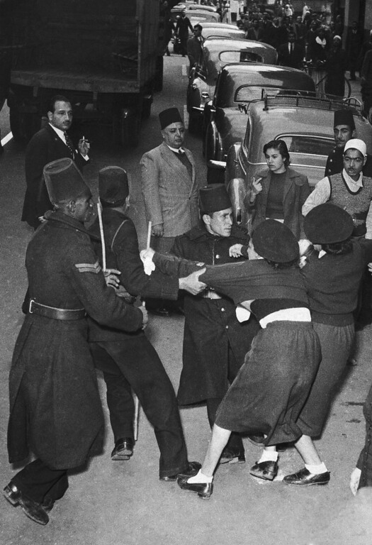. Egyptian women struggle with Cairo police on Jan. 26, 1952 as they are ousted from bank two days ago during anti-British disorders. Women were preventing customers from entering bank. Rioting Egyptian crowds ran wild through Cairo screaming anti-British, pro-Russian slogans. (AP Photo)