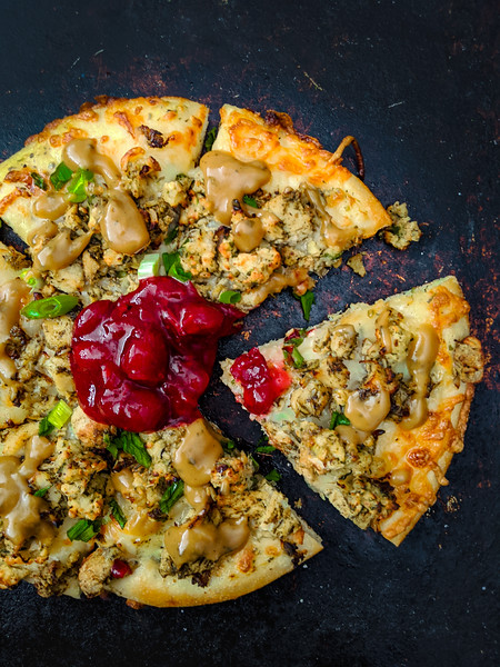 Christmas pizza with gravy slice out.jpg
