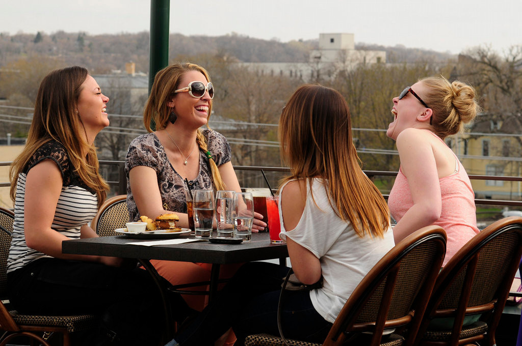 . Danielle Napoli, left, of Minneapolis, Marie Golden of St. Paul, Jessica Vietor of Austin, Minn., and Caitlin Lehner of St. Paul laugh over drinks on the patio at Louis above Cosetta in St. Paul on May 6, 2013. (Pioneer Press: Scott Takushi)