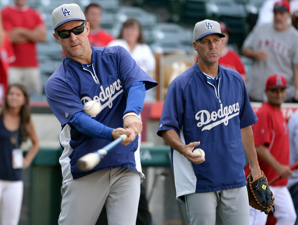 . Los Angeles Dodgers bench coach Tim Wallach hits infield practice prior to a baseball game against the Los Angeles Angels at Anaheim Stadium in Anaheim, Calif., on Thursday, Aug. 7, 2014.  (Photo by Keith Birmingham/ Pasadena Star-News)