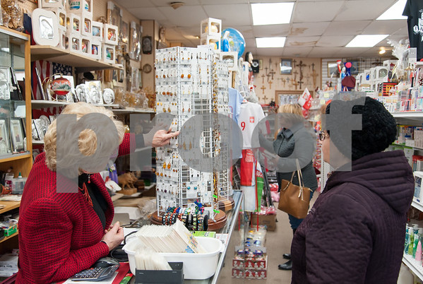 12/18/17 Wesley Bunnell | Staff Earrings for sale at the Quo Vadis gift shop on Broad St in Little Poland on Monday afternoon. Owner Krystyna Ovara, R, helps a customer with earrings.