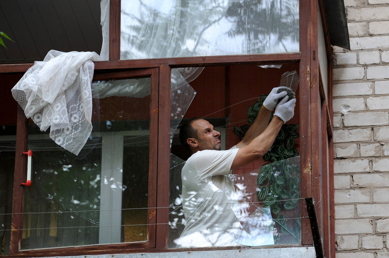 . A man repairs a damaged window after night of  combat between pro-Russia separatists with Ukrainian troops in the eastern Ukrainian city of Slavyansk on May 27, 2014. Ukrainian paratroopers and pro-Russian rebels were battling Tuesday for control of Donetsk airport after a day of intense firefights that marked a sharp escalation of the conflict in the east of the country. (VIKTOR DRACHEV/AFP/Getty Images)