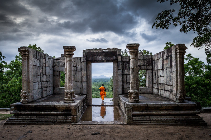 I was at the ancient buddhist temple of Yapahuwa, Sri Lanka. A storm was fast approaching but the scene before me was incredibly dramatic. There was only one thing missing! I waited until a monk kindly paused in the doorway, allowing me to take this shot just before it started to rain heavily. This photograph became the title image for the BBC series