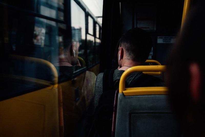 man on tram reflection evening warsaw summer erik witsoe nikon street.jpg