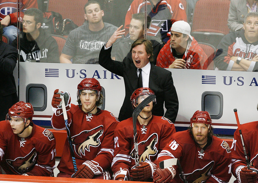 . Phoenix Coyotes head coach Wayne Gretzky, top, argues with the officials during the third period in an NHL hockey game against the Calgary Flames Saturday, March 1, 2008, in Glendale, Ariz.  The Flames defeated the Coyotes 3-1. (AP Photo/Ross D. Franklin)