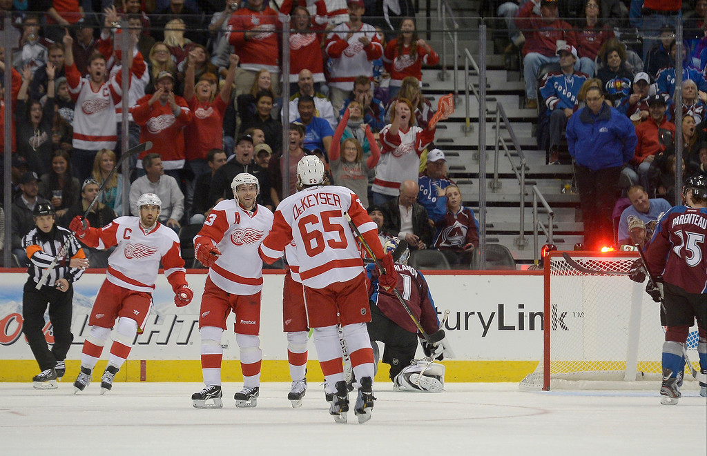 . Detroit Red Wings center Pavel Datsyuk (13) celebrates his goal  on Colorado Avalanche goalie Semyon Varlamov (1) as the puck hit the back of the net during the first period October 17, 2013 at Pepsi Center.(Photo by John Leyba/The Denver Post)