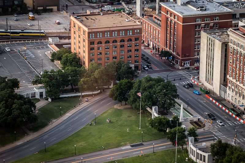 May 19 - Dealey Plaza, The Texas School Book Depository and the grassy knoll, Dallas, Texas.jpg