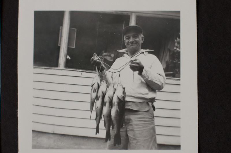 Circa:1955. Herman Weimer Sr. in front of our cabin holding his morning catch