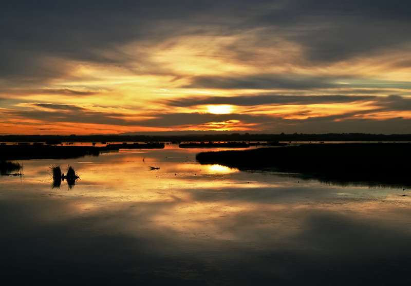 Sunset at the mouth of the Sturgeon River at Big Lake.