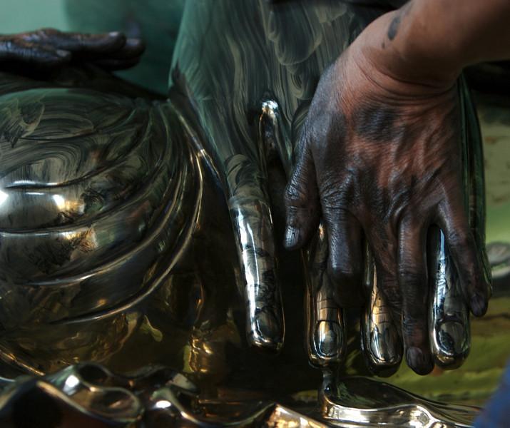Polishing the Buddha image