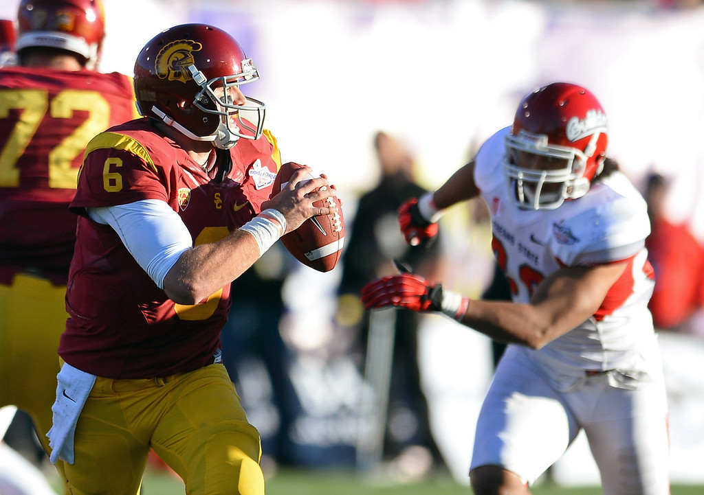 . LAS VEGAS, NV - DECEMBER 21:  Quarterback Cody Kessler #6 of the USC Trojans scrambles under pressure from Patrick Su\'a #30 of the Fresno State Bulldogs during the Royal Purple Las Vegas Bowl at Sam Boyd Stadium on December 21, 2013 in Las Vegas, Nevada. USC won 45-20.  (Photo by Ethan Miller/Getty Images)