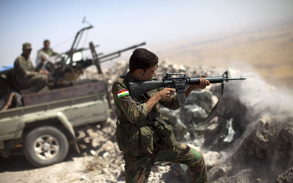 . An Iraqi Kurdish Peshmerga fighter fires at Islamic-State (IS) militant positions, from his position on the top of Mount Zardak, a strategic point taken 3 days ago, about 25  kilometers east of Mosul on September 9,2014. Kurdish forces in the north have been bolstered by US strikes and took control of Mount Zardak, a strategic site that provides a commanding view of the surrounding area, a senior US officer said. AFP PHOTO/ JM LOPEZ/AFP/Getty Images