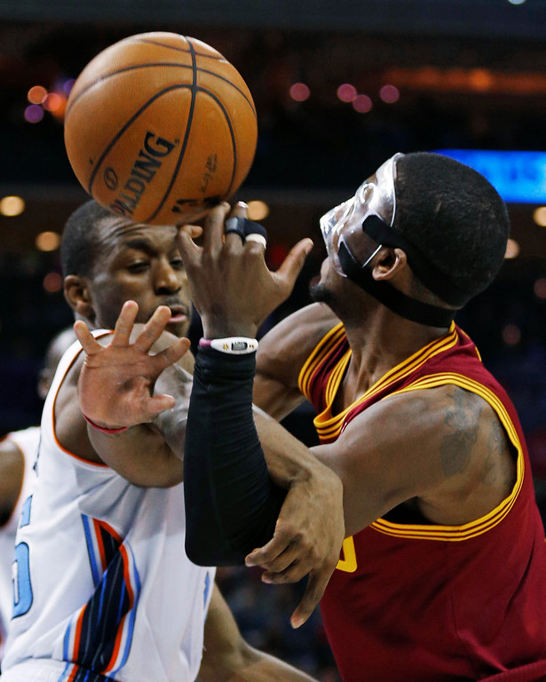 . Cleveland Cavaliers\' Kyrie Irving, right, is fouled by Charlotte Bobcats\' Kemba Walker during the second half of an NBA basketball game in Charlotte, N.C., Friday, Jan. 4, 2013. Cleveland won 106-104. (AP Photo/Chuck Burton)