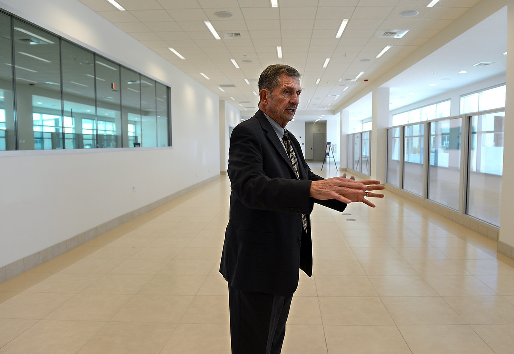 . AJ Wilson, executive director for the San Bernardino International Airport, talks about Thursday\'s grand opening of the regional airport\'s International arrivals building while giving a tour new the facility. The three-story, 40,000 square foot building features a customs and immigration passenger arrival area, administrative offices, screening booths, baggage claim area, public restrooms, and an aircraft arrival area large enough to accommodate aircraft such as a 747. (Staff photo by Rick Sforza/The Sun)