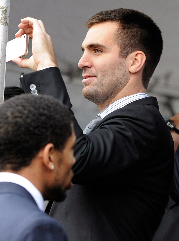 . Baltimore Ravens quarterback Joe Flacco records a send-off rally for the team on Monday, Jan. 28, 2013 in Baltimore. The NFL football team is leaving for New Orleans to face the San Francisco 49ers in the Super Bowl. (AP Photo/Steve Ruark)