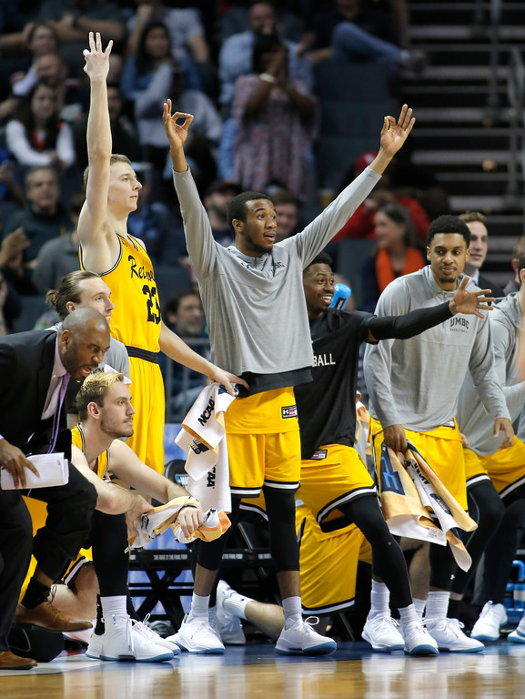 . UMBC players celebrate a teammate\'s basket against Virginia during the second half of a first-round game in the NCAA men\'s college basketball tournament in Charlotte, N.C., Friday, March 16, 2018. (AP Photo/Bob Leverone)