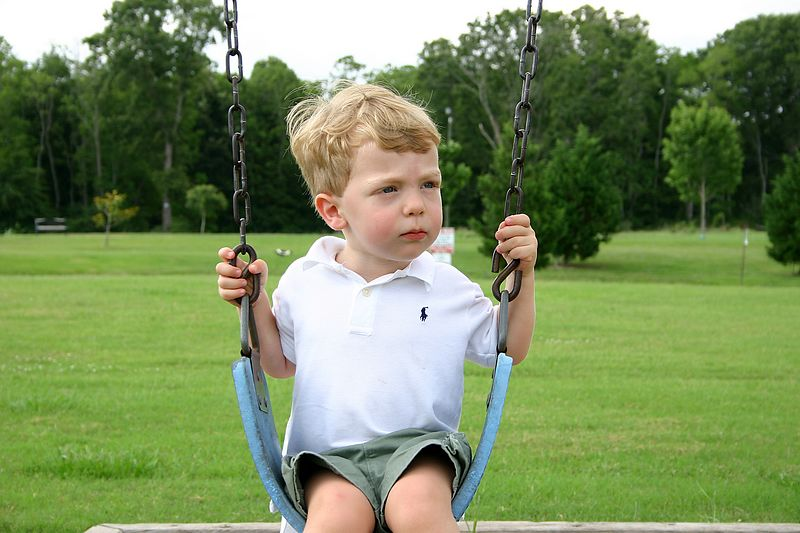 Swinging at the park.