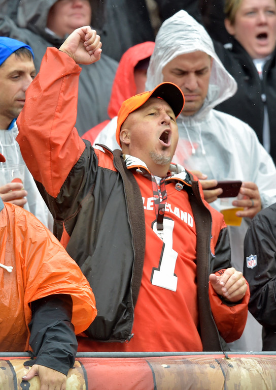 . A Cleveland Browns fan cheers during the first half of an NFL football game between the Cleveland Browns and the Pittsburgh Steelers, Sunday, Sept. 9, 2018, in Cleveland. (AP Photo/David Richard)