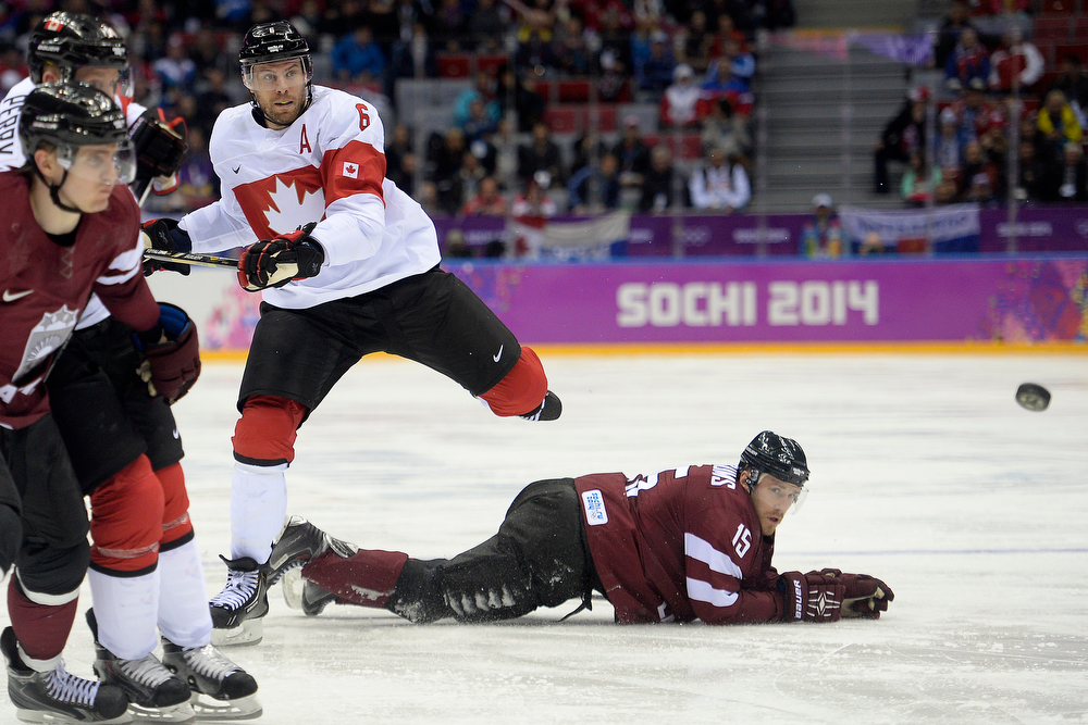 . Shea Weber (6) of the Canada jumps over Martins Karsums (15) of the Latvia after taking a shot during the third period of Canada\'s 2-1 win over Latvia. Sochi 2014 Winter Olympics on Wednesday, February 19, 2014 at Bolshoy Ice Arena. (Photo by AAron Ontiveroz/ The Denver Post)