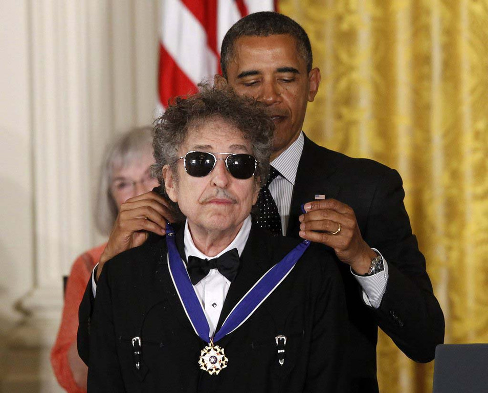 . President Barack Obama presents rock legend Bob Dylan with a Medal of Freedom on Tuesday, May 29, 2012, in a White House ceremony. (Associated Press: Charles Dharapak)