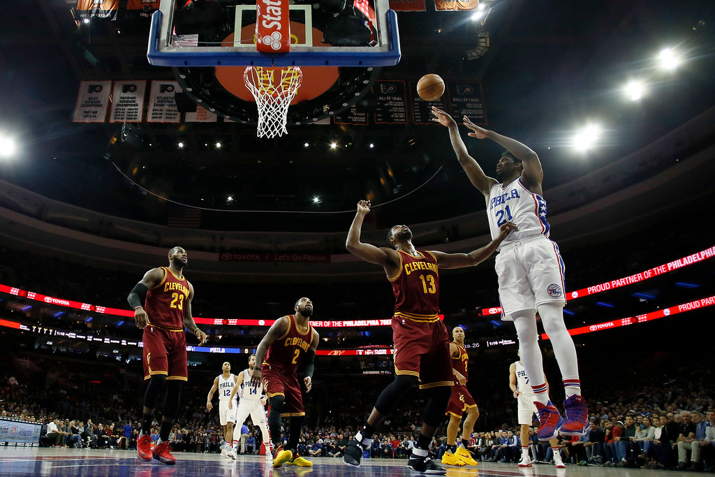 . Philadelphia 76ers\' Joel Embiid (21) goes up for a shot against Cleveland Cavaliers\' Tristan Thompson (13) during an NBA basketball game, Sunday, Nov. 27, 2016, in Philadelphia. (AP Photo/Matt Slocum)