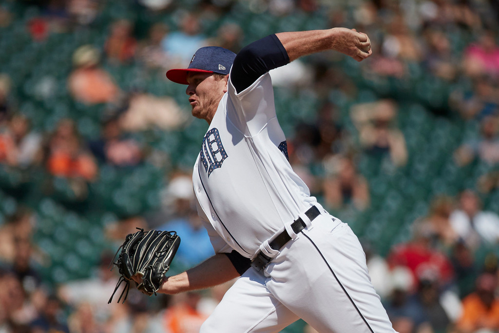 . Detroit Tigers relief pitcher Justin Wilson (38) pitches in the ninth inning against the Cleveland Indians in the first baseball game of a doubleheader in Detroit, Saturday, July 1, 2017. Detroit won 7-4. (AP Photo/Rick Osentoski)