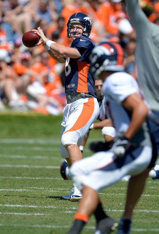 . Denver Broncos QB Peyton Manning (18) throws a pass to Eric Decker (87) during training camp August 5, 2013 at Dove Valley. (Photo By John Leyba/The Denver Post)