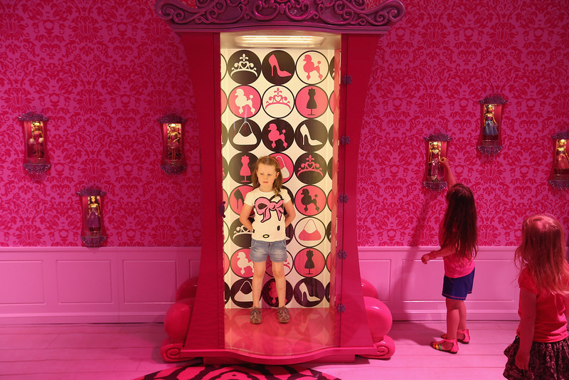. Lara, 6, stands in a special armoire in Barbie\'s bedroom  while visiting the Barbie Dreamhouse Experience with her friends Josi and Luna on May 16, 2013 in Berlin, Germany. The Barbie Dreamhouse is a life-sized house full of Barbie fashion, furniture and accessories and will be open to the public until August 25 before it moves on to other cities in Europe.  (Photo by Sean Gallup/Getty Images)