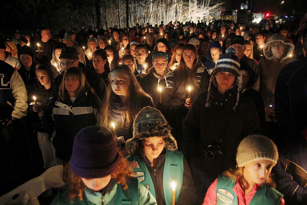 . Many hold candles at the ceremony at the Lunenburg gazebo in support of student Isaac Phillips on Sunday night. SENTINEL & ENTERPRISE/ JOHN LOVE