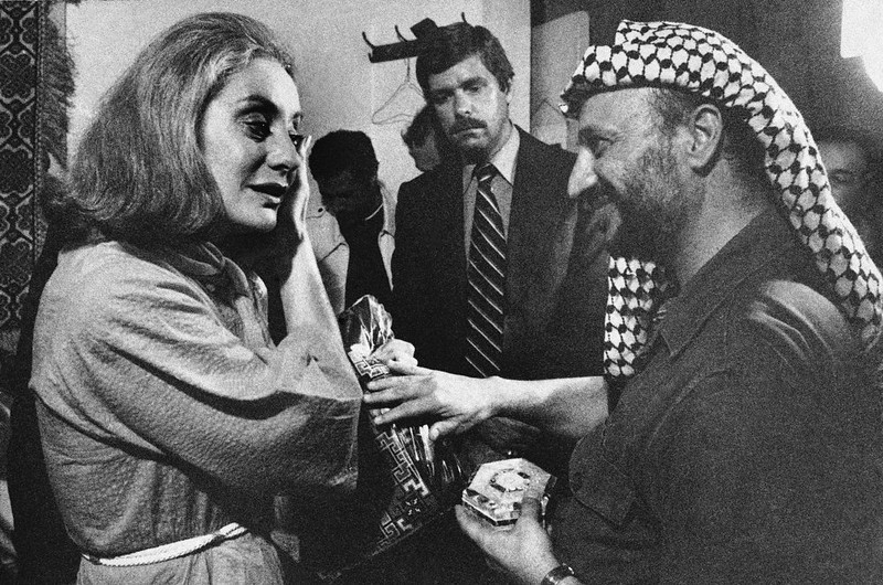 . Palestinian leader Yasir Arafat presents Barbara Walters of ABC with a handmade dress and mother- of-pearl box following an interview with him in Beirut, Sept. 2, 1977. (AP Photo/Harry Koundakjian)