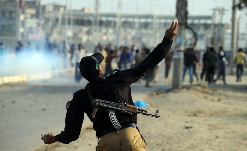 . A Pakistani policeman throws a stone toward Christian demonstrators during a protest against the attack on the homes of members of the Christian community by Muslim demonstrators in Lahore on March 10, 2013. Christians demonstrated around Pakistan on March 10 to protest after a Muslim mob torched more than 100 Christian homes following allegations of blasphemy. More than 3,000 Muslims rampaged through Joseph Colony, a Christian area of the eastern city of Lahore, on March 9 after allegations that a Christian had made derogatory remarks about the Prophet Mohammed three days earlier. Arif Ali/AFP/Getty Images
