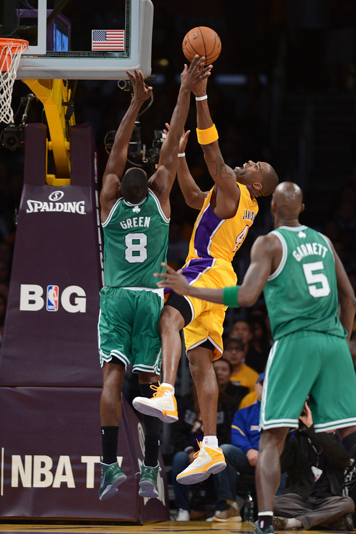 . Lakers Antawn Jamison shoots two as Celtics\' Jeff Green and Kevin Garnett defends during first half action at Staples Wednesday.  Photo by David Crane/Staff Photographer