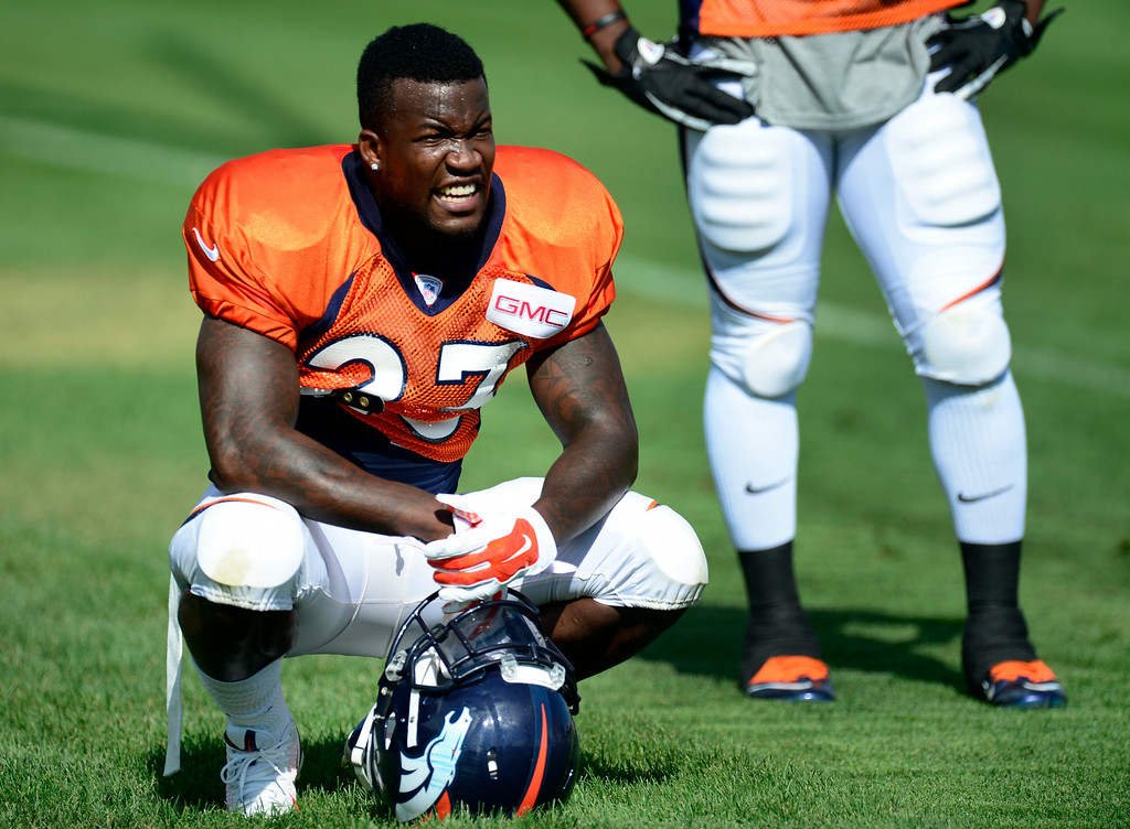 . Ronnie Hillman (23) takes a quick rest between drills on Saturday. The Denver Broncos football team hold their workouts for the team during mini-camp at Dove Valley in Centennial on Saturday, July 26, 2014. (Photo by Kathryn Scott Osler/The Denver Post)