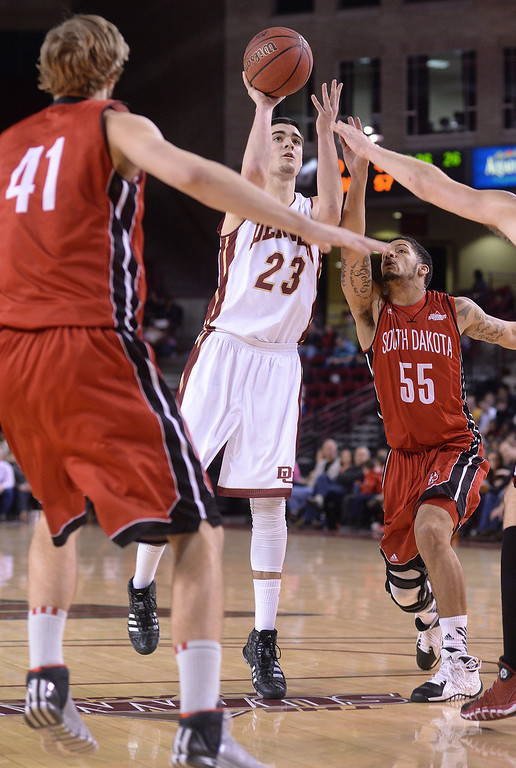 . DENVER, CO. - FEBRUARY 8, 2014: Denver junior guard Brett Olson (23) put in two of his 30 points Saturday night. The University of Denver defeated South Dakota 75-67 Saturday night, February 8, 2014. Photo By Karl Gehring/The Denver Post