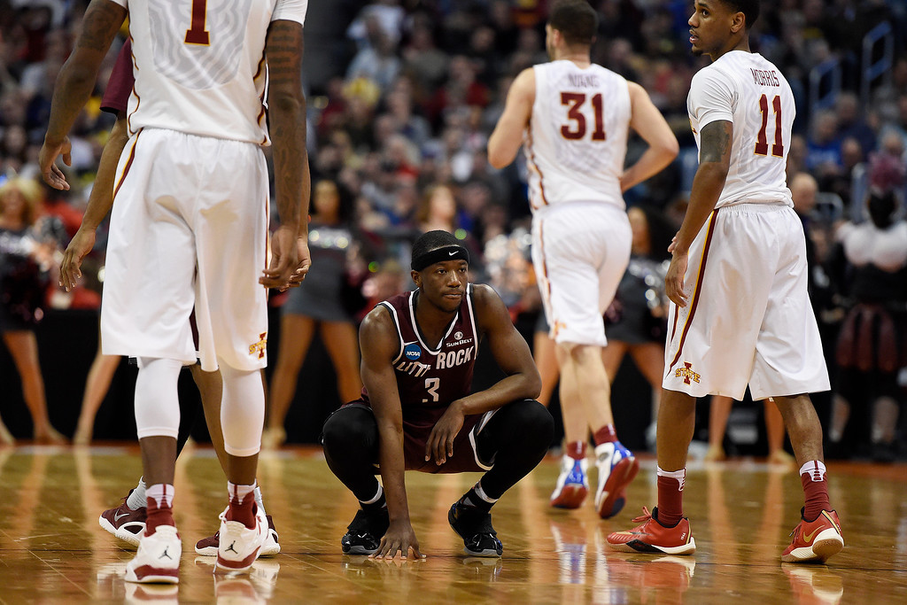 . DENVER, CO - MARCH 19: Josh Hagins (3) of the Arkansas Little Rock Trojans squats on the court in the waning seconds against the Iowa State Cyclones during the second half of Iowa State\'s 78-61 second round NCAA Tournament game win on Saturday, March 19, 2016. (Photo by AAron Ontiveroz/The Denver Post)
