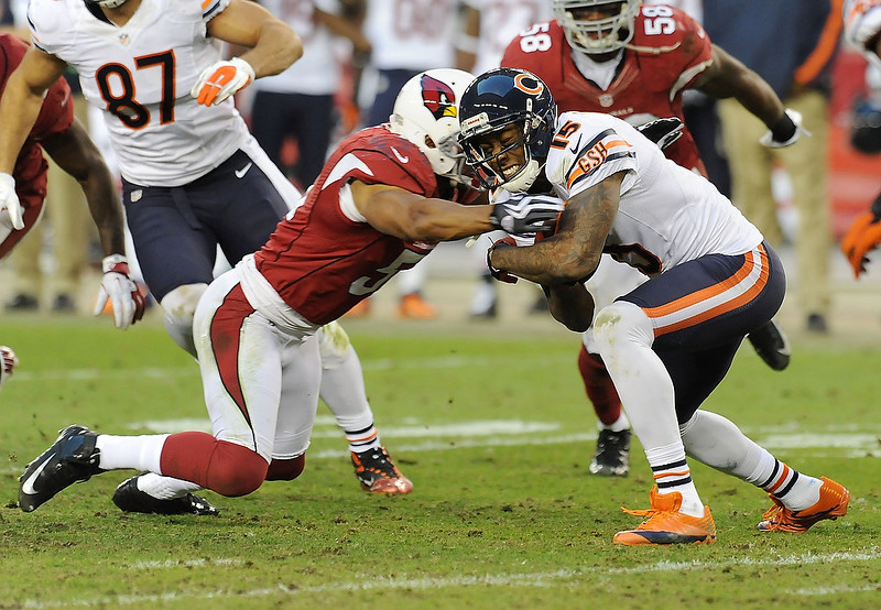 . Paris Lenon #51 of the Arizona Cardinals tackles Brandon Marshall #15 of the Chicago Bears at University of Phoenix Stadium on December 23, 2012 in Glendale, Arizona. Bears won 28-13.  (Photo by Norm Hall/Getty Images)