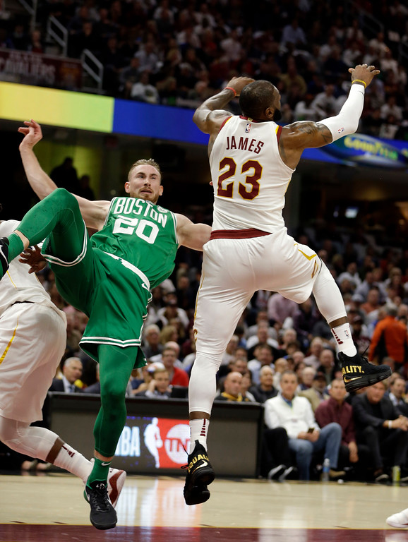 . Boston Celtics\' Gordon Hayward (20) falls as Cleveland Cavaliers\' LeBron James (23) reaches for a loose ball in the first half of an NBA basketball game, Tuesday, Oct. 17, 2017, in Cleveland. Hayward broke his left ankle on a play. (AP Photo/Tony Dejak)