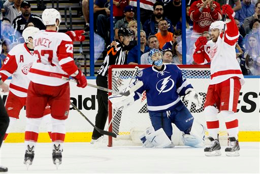 . Tampa Bay Lightning goalie Ben Bishop (30) looks up as the Detroit Red Wings celebrate scoring the first goal of the night during Game 1 of an NHL hockey first-round playoff series, Thursday, April 16, 2015, in Tampa, Fla. (Dirk Shadd/Tampa Bay Times via AP)